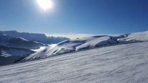 foto pista sci con meteo soleggiato dove utilizzare maschera da sci con lente fumo